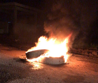 Three arrested as Black Bush Poulder farmers burn tyres to protest flooding